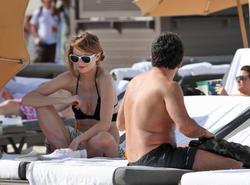 http://img283.imagevenue.com/loc214/th_311757771_Mischa_Barton_Bikini_Candids_on_the_Beach_in_Miami_December_27_2011_089_122_214lo.jpg